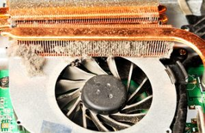 53979046 - closeup photo of a dusty dirty fan inside laptop